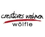 Logo creatives wohnen wölfle